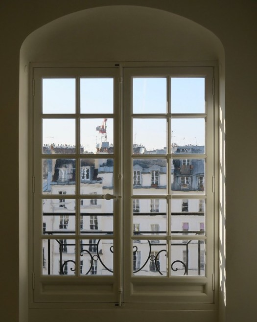 a window upon rooftops