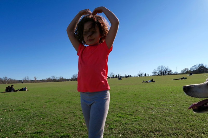 Anais, making a heart with her arms