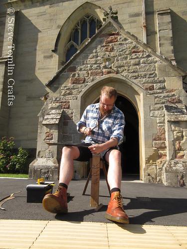 Peening an austrian scythe at St John's church, Yorkshire