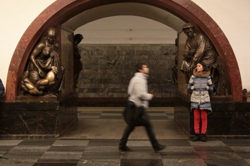 Bronze sculptures along the Moscow Metro platform