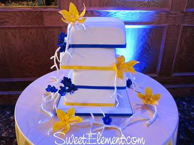 Offset Square Blue Amp Yellow Wedding Cake With Cymbidium Or