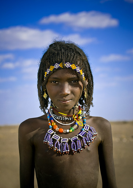Afar Tribe Girl With Big Necklace And Braided Hair Assait