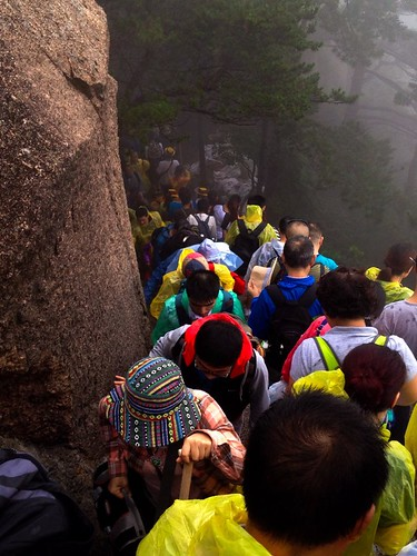 crowds of chinese people hiking on huangshan mountain in anhui