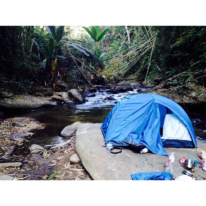 camping on a rock in a river in the middle of the jungle in doi pha hom pok mountain