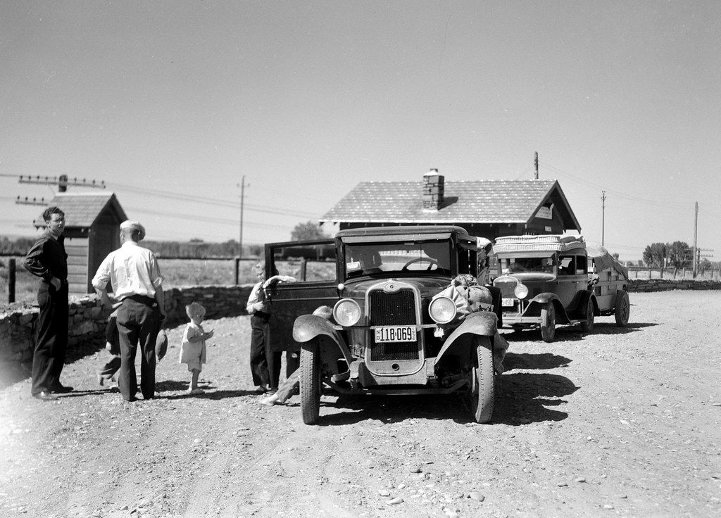 Rothstein, Arthur, photographer. Part of the daily motorcade of drought refugees. The Montana-North Dakota state line. July, 1936.