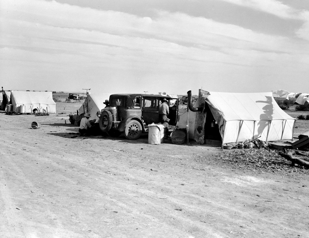 Lange, Dorothea, photographer. Squatter camp on county road near Calipatria. Forty families from the dust bowl have been camped here for months on the edge of the pea fields. There has been no work because the crop was frozen. Mar, 1937.