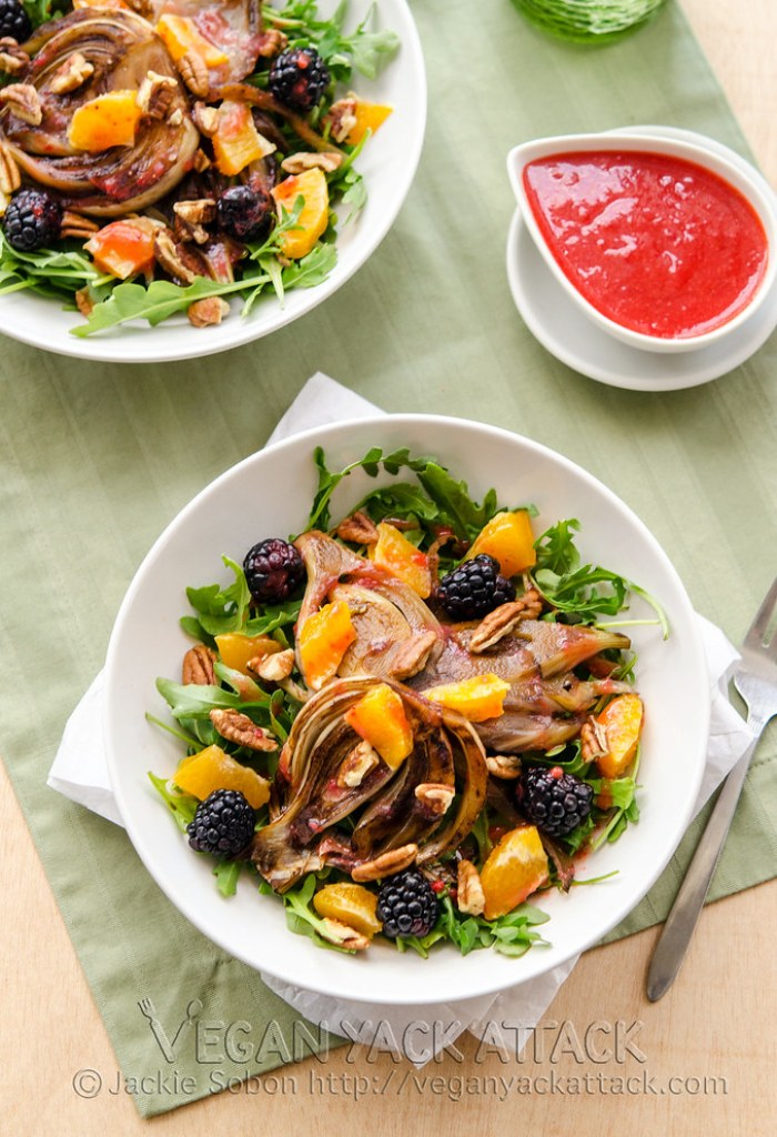 This Fruity Roasted Fennel Salad is perfect for spring! Fresh fruit, roasted balsamic fennel, peppery arugula and a superb strawberry vinaigrette.