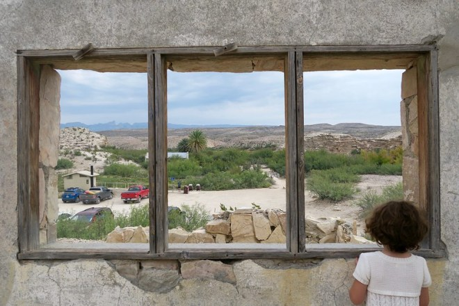 Anais, looking out a window at Big Bend