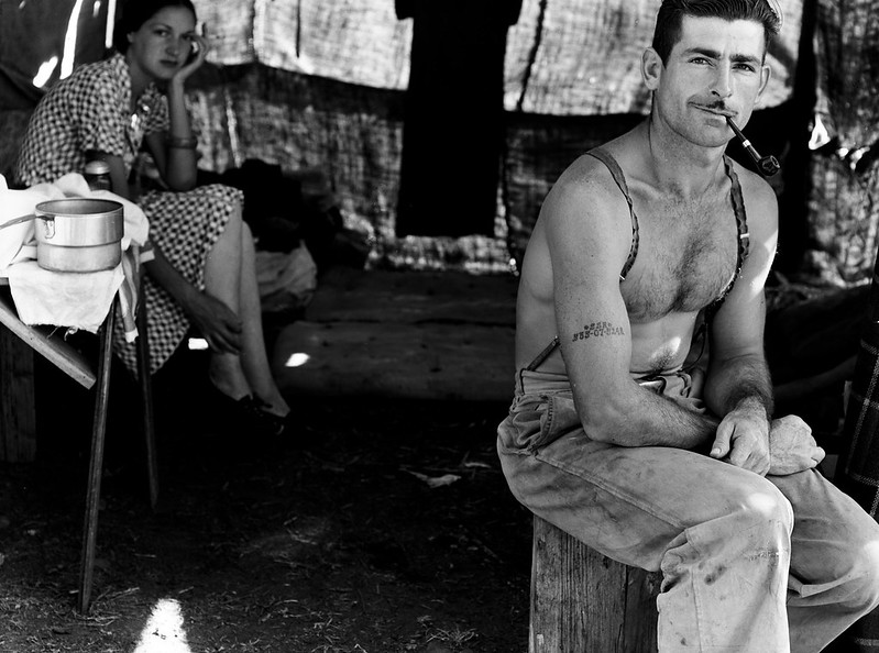 Lange, Dorothea, photographer. Unemployed lumber worker goes with his wife to the bean harvest. Note social security number tattooed on his arm. Oregon.
