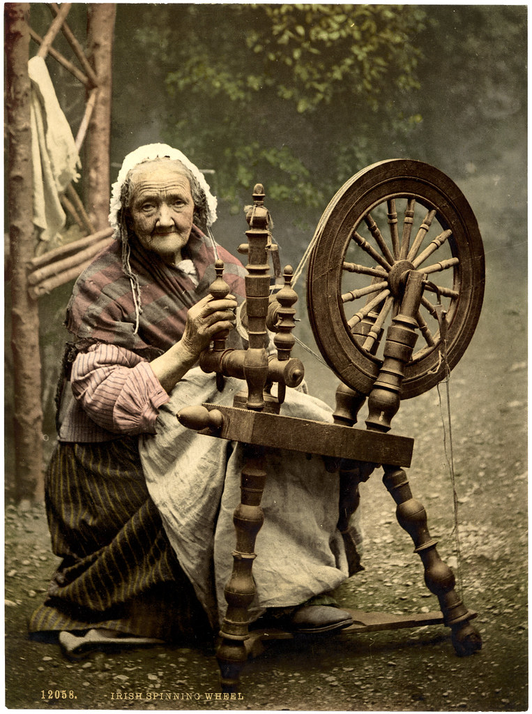 Irish spinner and spinning wheel. County Galway, Ireland. [between and Ca. 1900, ca. 1890]