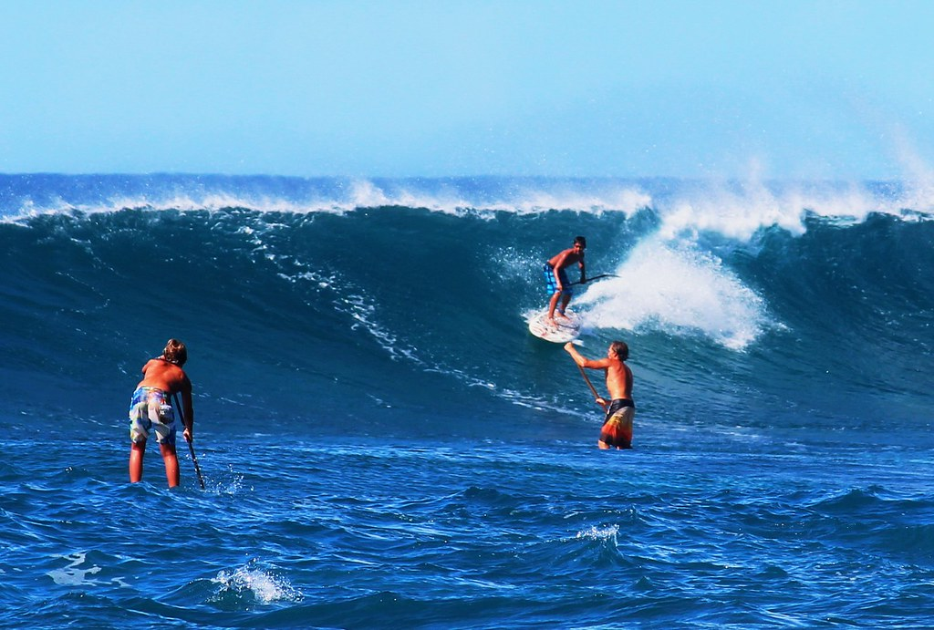 Stand Up Paddle Surfing On The Huge Waves Off Sunset Beach