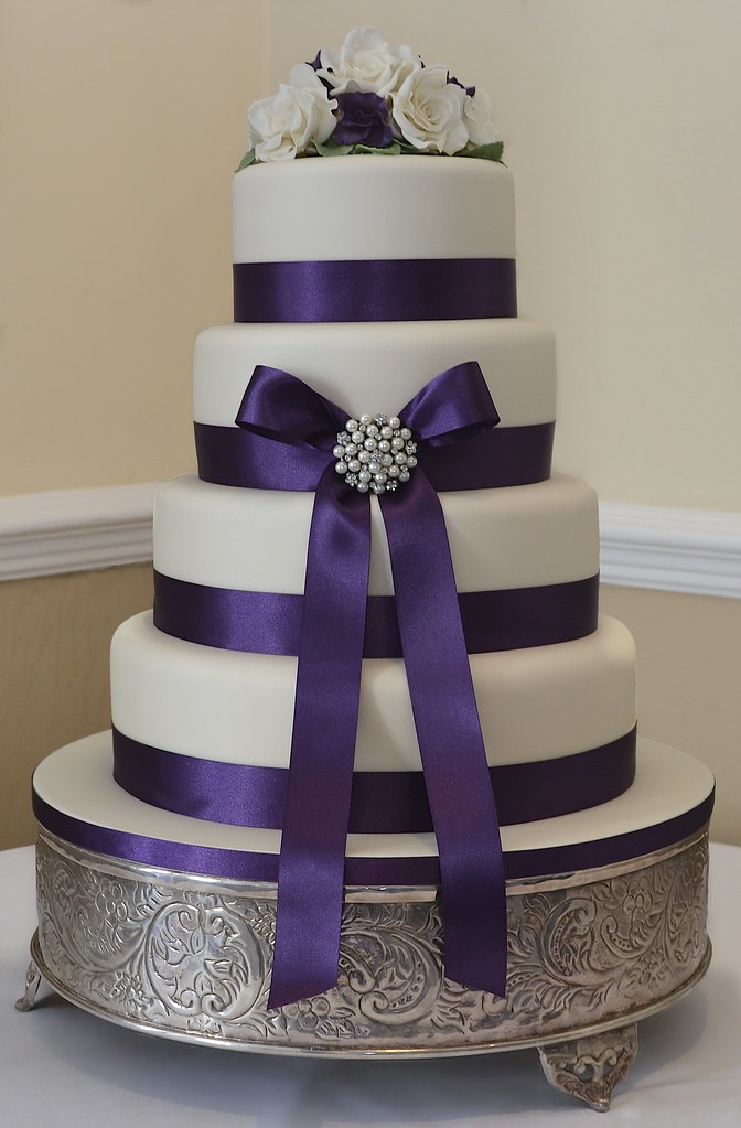 Purple And Ivory Wedding Cake Purple Ribbon And Bow On A