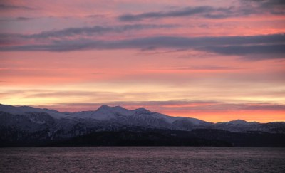 Purple waters sunset, pink dusky clouds, snowy mountains ...