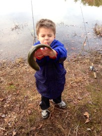 Photo of Boy losing his grip on a trout.