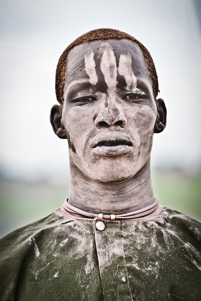 A Mundari Male Covered In Ash And Orange Hair Bleached In