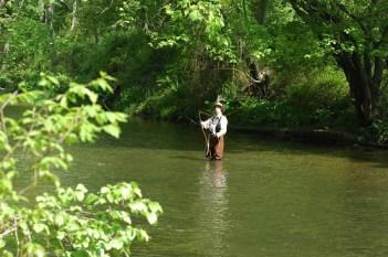 Man fishing in stream