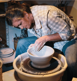 Polly Wellford at her potter's wheel