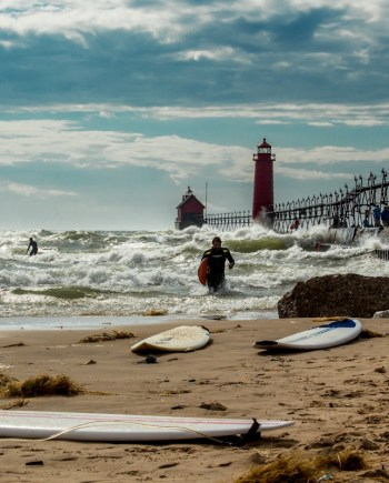art photograph of surfer on lake michigan