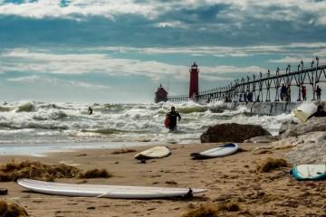 Surfers on Lake Michigan at grand haven Michigan photograph by bob walma