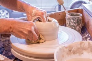 Cyndi Casemier throwing on the potter's wheel