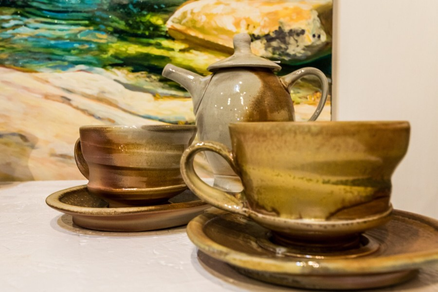 Wood fired cups and saucers with a teapot by julie Devers
