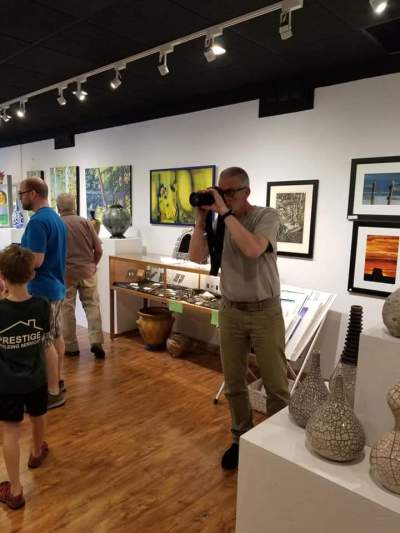 Bob Walma taking pictures at C2C gallery