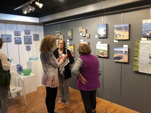 Lori Reed describing her mixed media artwork
