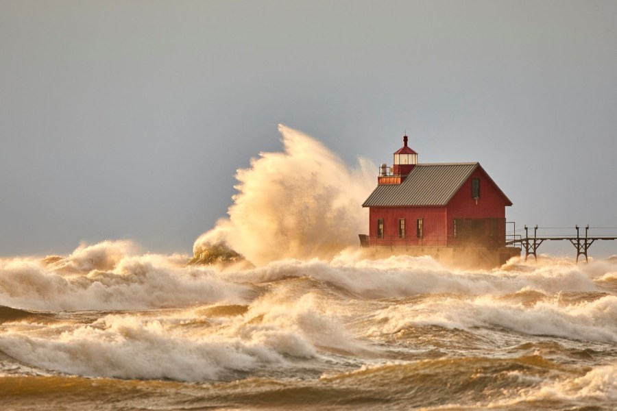 Huge winds at the grand haven lighthouse. Image by Bob Walma.
