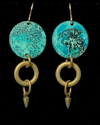 handmade earrings with a disc and a charm