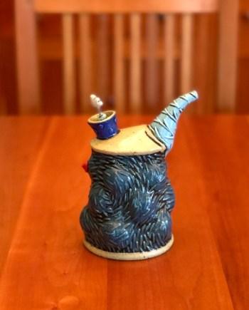 blue oil pourer on a table