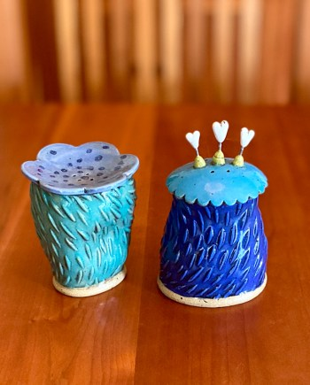 handmade salt and pepper shakers on a table