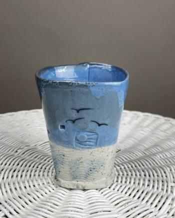 Handmade ceramic tumbler by Cyndi CAsemier with beach sand