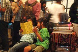 Jasmine & Icha busy reading amidst the crowd coming to see Jasmine's artworks