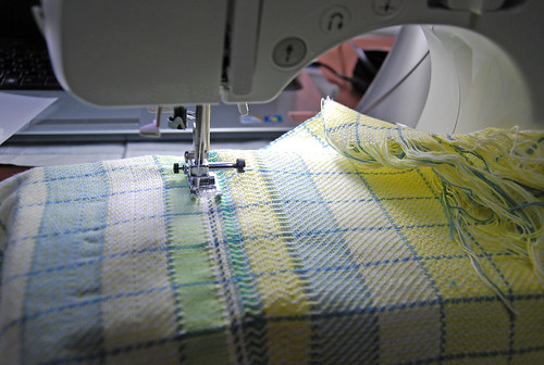 Sewing machine stitching handwoven cloth