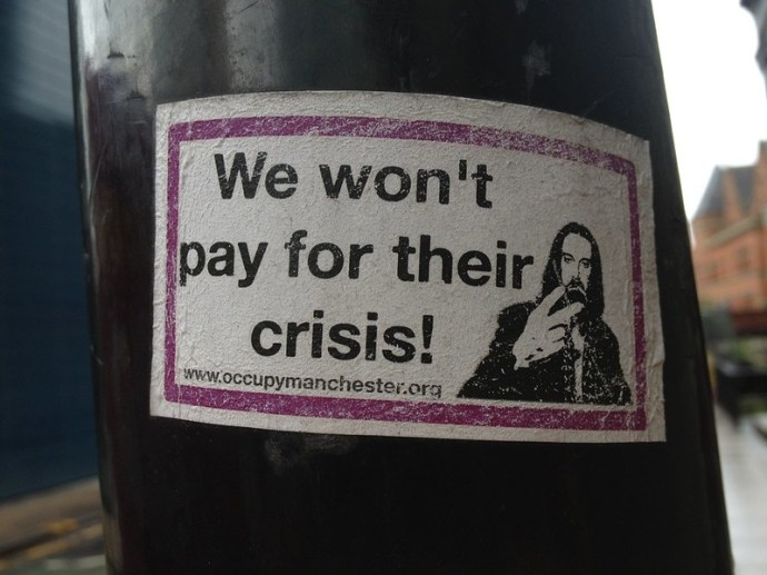 We won't pay for their crisis - Mancunian protest sticker
