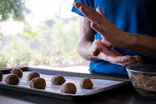 rolling each one in cinnamon-sugar