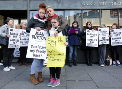 Gwen Connell with two of her three daughters at a protest in February