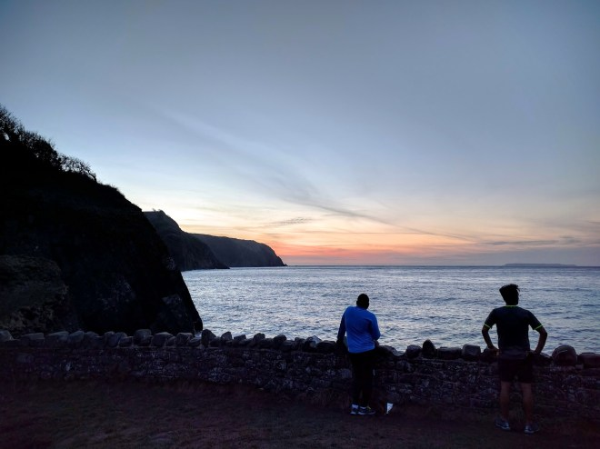 Arun admiring the sunset, while I act like I'm scouting the IM Wales venue, Tenby, on the other side of the channel.