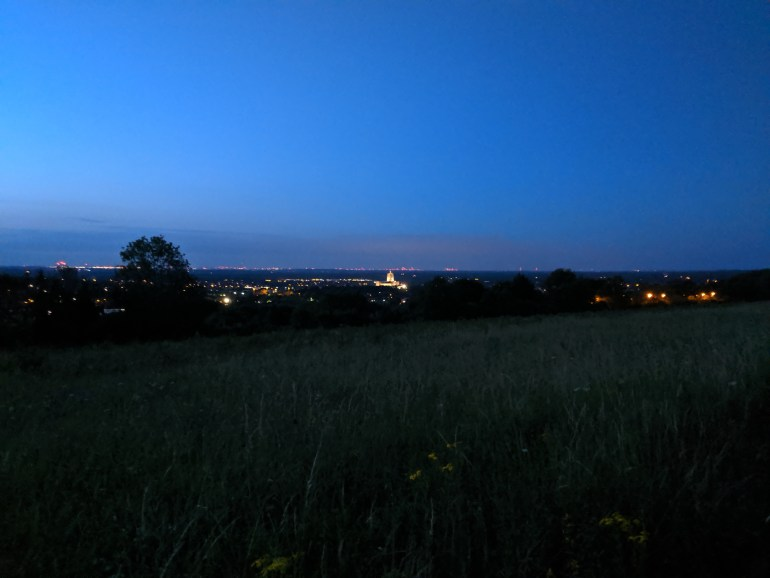 Night view from the Hogs back—Guildford cathedral lit up, and red lights of London marking the horizon