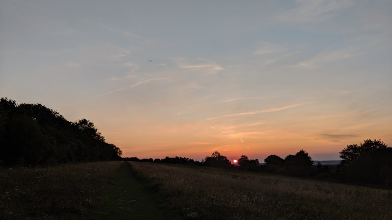 Sunset with a paramotor flying away