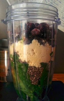 Smoothie prep - Spinach, chia seeds, whey protein, blueberries. Banana & other berries hidden.