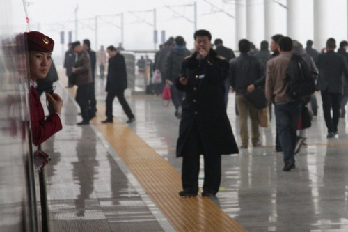 CRH staff await departure time from Luoyang Longmen Railway Station