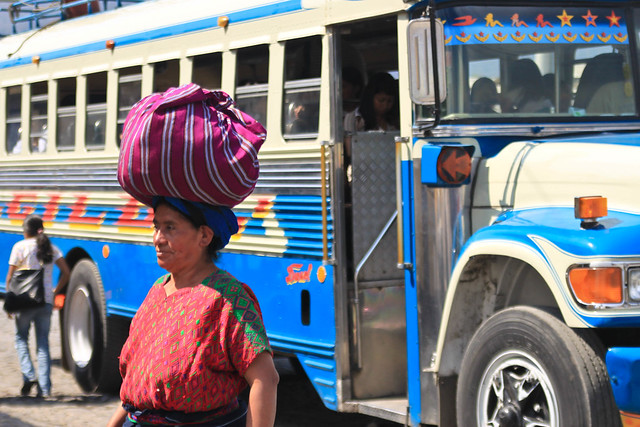 Woman & Chicken Bus - Antigua, Guatemala