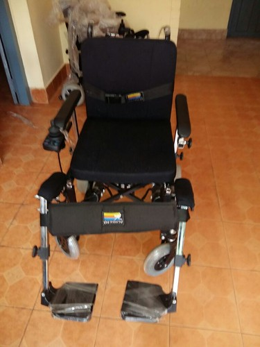A motorised wheelchair bought from Keltron Ltd, Kerala as part of a project for the differently abled persons in a rural village of India