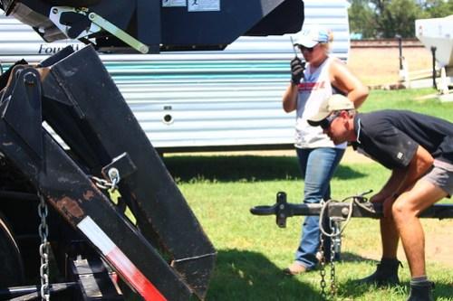 Guiding Brandon onto the header trailer.
