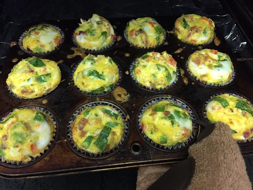 Egg muffins! Egg, cheese, spinach, tomato, bacon, green onion, onion, turkey sausage, bacon, and seasoning.