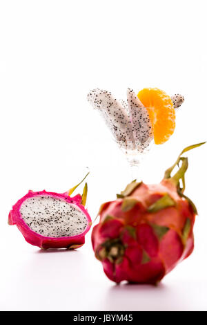 The slightly leafy rind and vibrant purple color of the pitaya is giving this exotic fruit its dragon-like appearance, - Stock Photo