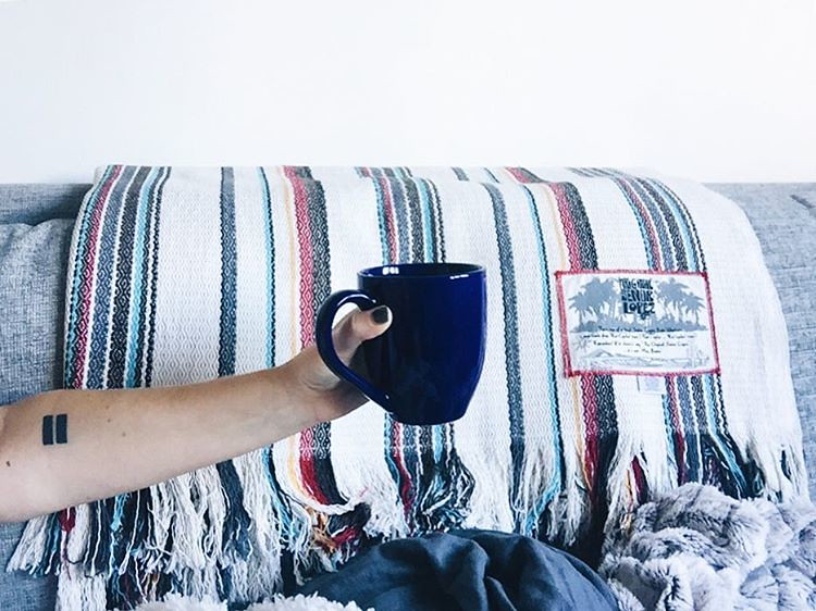 Coffee + a book + the Mexican blanket we brought home from the States... Sunday morning, you're looking good. ↠∆✹☾. : : #slowliving #morningslikethese #mymonthofsundays #liveauthentic #weekendvibes #originalsenorlopez #blanket #bohostyle #interiordesign #