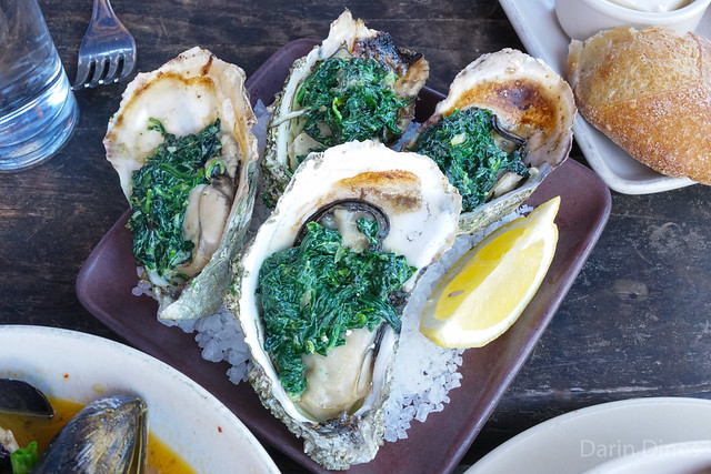 Grilled Oysters Rockefeller spinach, pernod, onions, lemon zest, cream