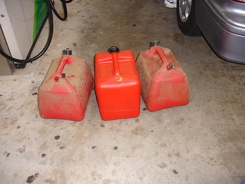 Hurricane Katrina - Av Fills Gas Cans for Trip to Coast